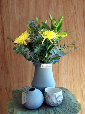 Selection of vases and an arrangement of yellow Disbud Chrysanthemums and Asiatic Lilies.